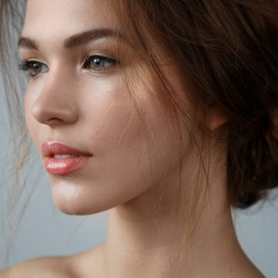 Portrait of beautiful woman with natural make up and hairstyle